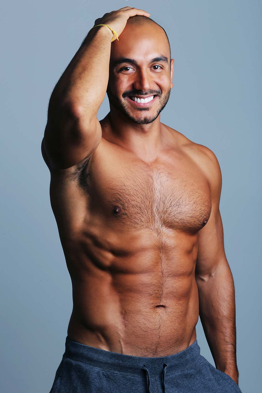six packs model man on a solid background sample before photo editing