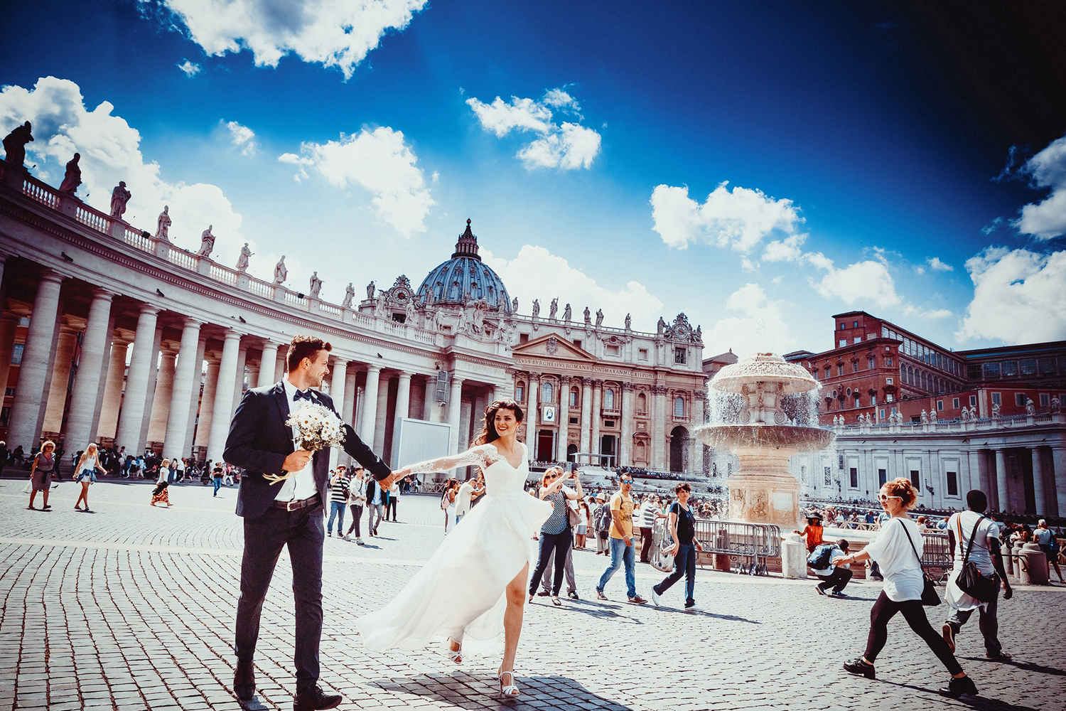 Wedding photo holding hands in vatican before retouching people