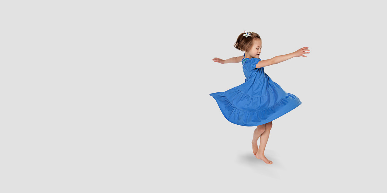 A little girl wearing blue dress before photo retouching
