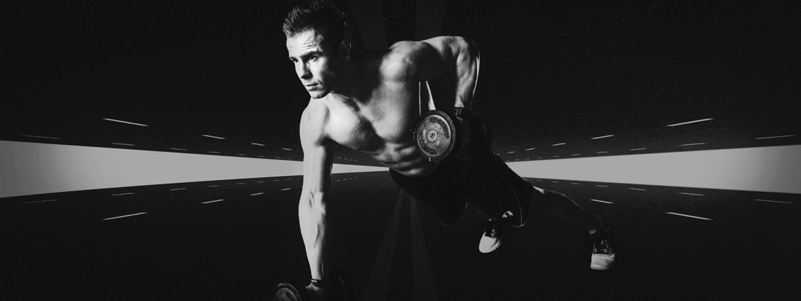 Body retouching service lifting weights model on a dark background